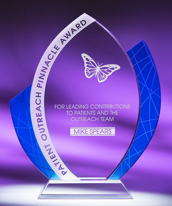 Sensation Glass Award  http://www.edco.com The iconic Sensation Glass Award combines rich textures with a sleek organic teardrop shape. Measuring 9.5'' in height, it features contrasting blue accent panels on the sides which highlight the clear optic crystal award and its inscription.