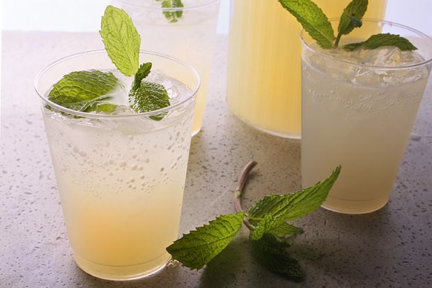 Ginger Mojitos for a Crowd-Infusing lots of mint and freshly grated ginger into a simple syrup takes the muddling out of these Mojitos. Since the base of the cocktail is made in advance, all you have to do is add ice and club soda—perfect for parties or your next tailgate.