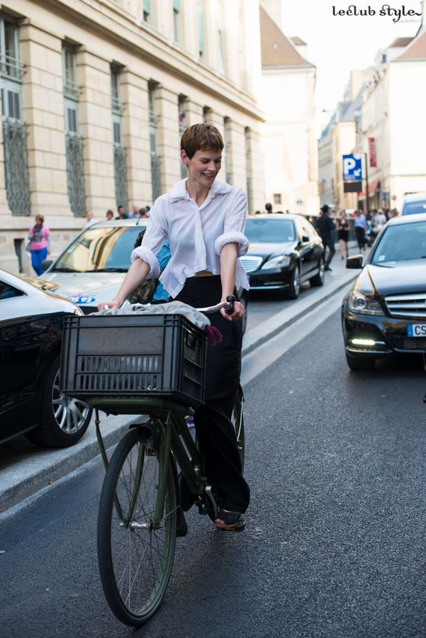 Womenswear Street Style. Saskia de Brauw riding a bike after a fashion show by Ángel Robles. Fashion Photography from Paris Fashion Week.