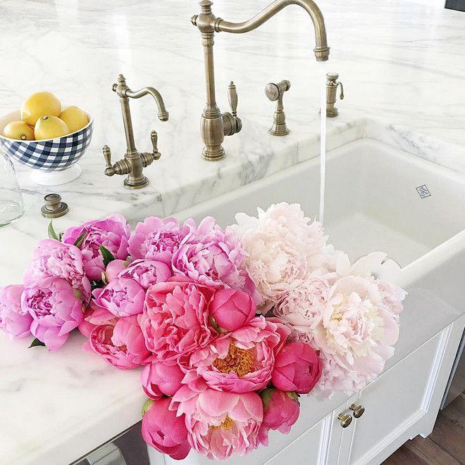 Kitchen farmhouse sink and antique brass faucet. white kitchen with Kitchen…