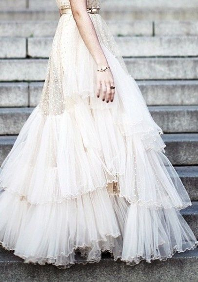For the bohemian bride, a ruffled tulle dress with vintage gold accents is a gorgeous choice.
