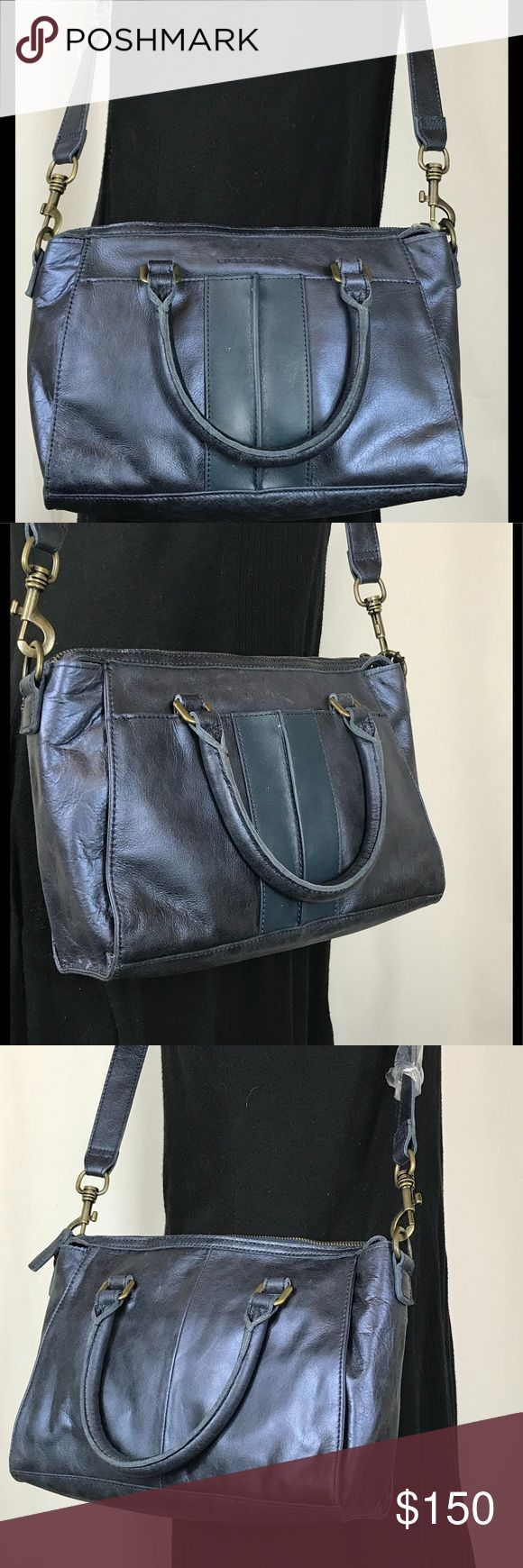 "Liebeskind molly leather satchel in dark blue NWT Liebeskind molly leather satchel in dark blue NWT. 1 large outside pocket worth a magnet closure, 1 Large zippered inside pocket and 3 medium sized pockets. Long adjustable detachable cross body strap and 2 small carry handles. Cotton lining with blue leather trim. Measurements: 18"" X 8"" X 3.5"" New with tags! Liebeskind Bags Satchels"