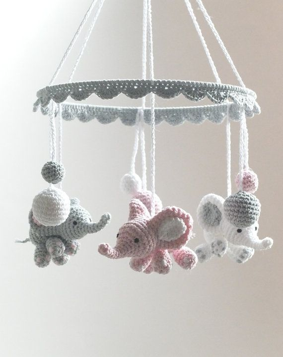 This lovely crochet baby mobile with cute baby elephants, little good luck bringers for a newborn, makes a beautiful, one of a kind baby shower gift. The baby mobile is made out of 100% cotton yarn in white, pink and gray. It is ideal to hang over a baby crib, baby changing table or simply anywhere in the nursery just to brighten up the babys room.  The item is handmade with love and care.  Color: white, pink, gray Material: 100% cotton yarn, metal ring Size: diameter of the ring - 25 cm…