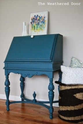 An antique secretary desk in a deep teal from Reeves at The Weathered Door