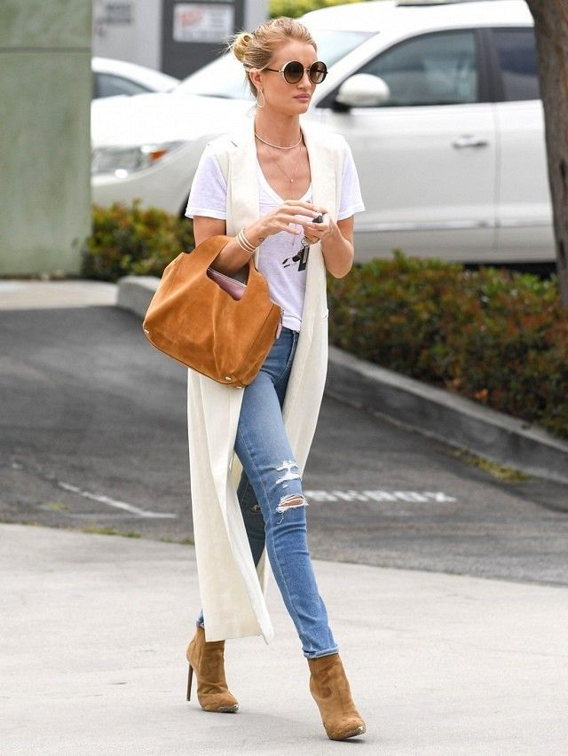 Rosie is known for taking a simple jeans and tee look to the next level, like adding a long duster coat here.