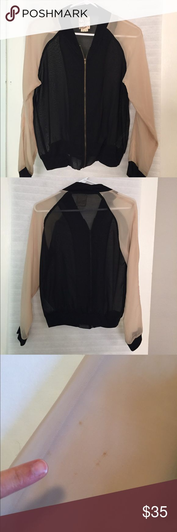 Sheer black and nude zip up jacket Brand: Tulle. Sheer black and nude zip up jacket. Small stain on sleeve. Smoke free and pet free home. Jacket can be dressed up or down! Tulle Jackets & Coats