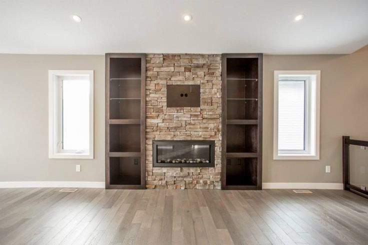 Built in fireplace with full stone accent wall.