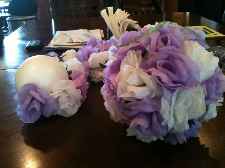 I've seen these on pinterest a million times. Now I've made them for an anniversary party. Most pins will tell you to use floral foam and floral pins but I found it cheaper to use regular foam balls from Walmart and fake bouquet flowers that already have the wire attached. Just cut them one inch form the top (Mortisha Adams style) and poke them into the ball. BAM! flower ball hahaha