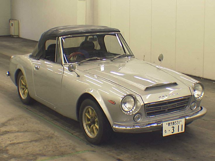 Classic Fairlady! Would love one of these in my garage for nice summer day cruises! :)