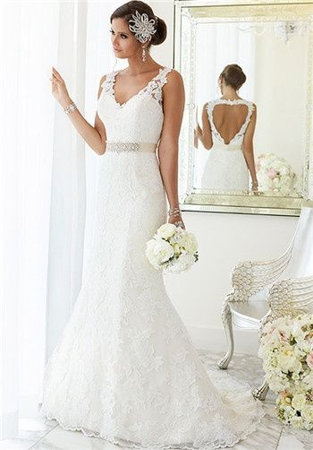 "For brides looking for that figure-flattering wedding dress, Essense of Australia has created this fit-and-flare gown with hand-sewn Diamante beading on Lace over Lavish Satin. At the top, the dress features illusion Lace shoulder straps covering a sweetheart neckline. At the knees, the dress blooms out and is finished with scalloped Lace on the hem and train. The back zips up under crystal buttons and features a heart-shaped keyhole back. Make this dress your own with a 1.5"" Grosgrain ..."