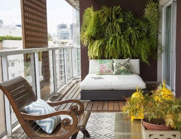Place a comfy bed on your balcony because why not? Add greenery with help from hanging plants situated on the wall. Add more chairs with the remaining space to complete the décor.