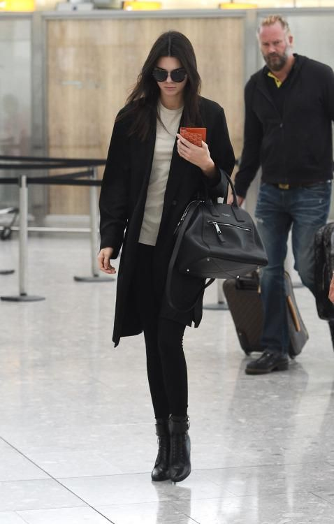 Kendall Jenner wearing Prada Top-Buckle Lace-Up Booties, Marc Jacobs Smooth Medium Incognito Bag in Black Nickel and Goyard Passport Holder