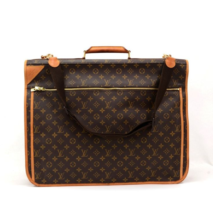 Authentic Louis Vuitton Portable Bandouliere Garment bag in monogram canvas. It is spacious and comes with many compartments (exterior and interior) and pockets. Carried in hand or on the shoulder. It is a great companion wherever you go. Item comes with 3 hangers, removable pocket, name tag and shoulder strap. #LouisVuitton @fmasarovic