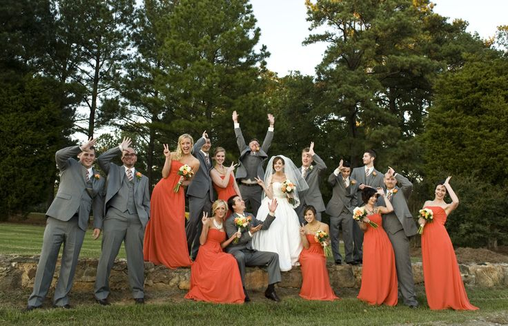 Peach and orange bridal party accents coupled with grey suits.....a statement!    Gorgeous photo by Swank Photo Studio | http://brds.vu/xgpcT4 via @BridesView #wedding #photography