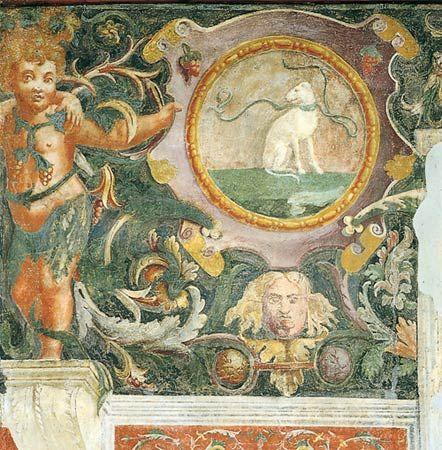 Palazzo Te - Dettagli Impresa del cane(Gianfrancesco) CORPO:Cane sedente, con museruola.ANIMA:Donec (fino a quando).SIGNIFICATO:  Fedeltà; non accertato il nesso con il motto.   Device of the dog(Gianfrancesco) BODY:Seated dog with muzzle.SOUL:Donec (until when).MEANING:  Faithfulness, link with the motto is unclear.