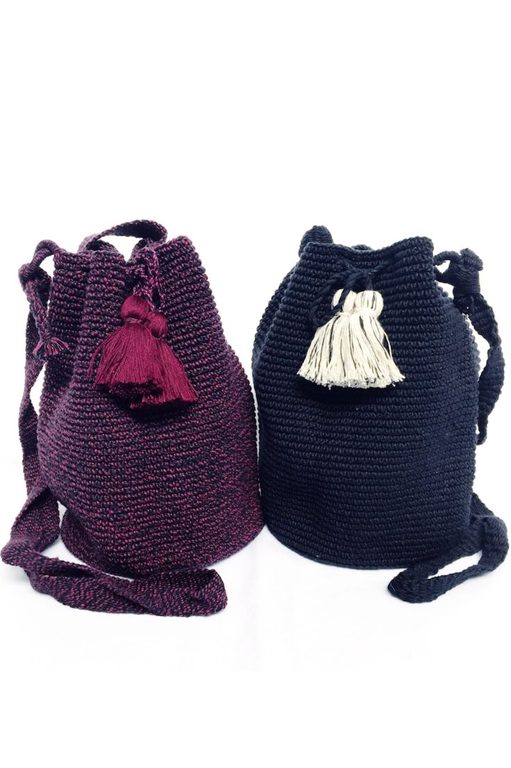 """B&W Bucket Bag hand-crocheted by female artisans in Guatemala. Drawstring closure adorned with lush, oversized tassels. 100% Cotton. 13"""" W, 10.5"""" H, 7"""" D Strap length is adjustable."""
