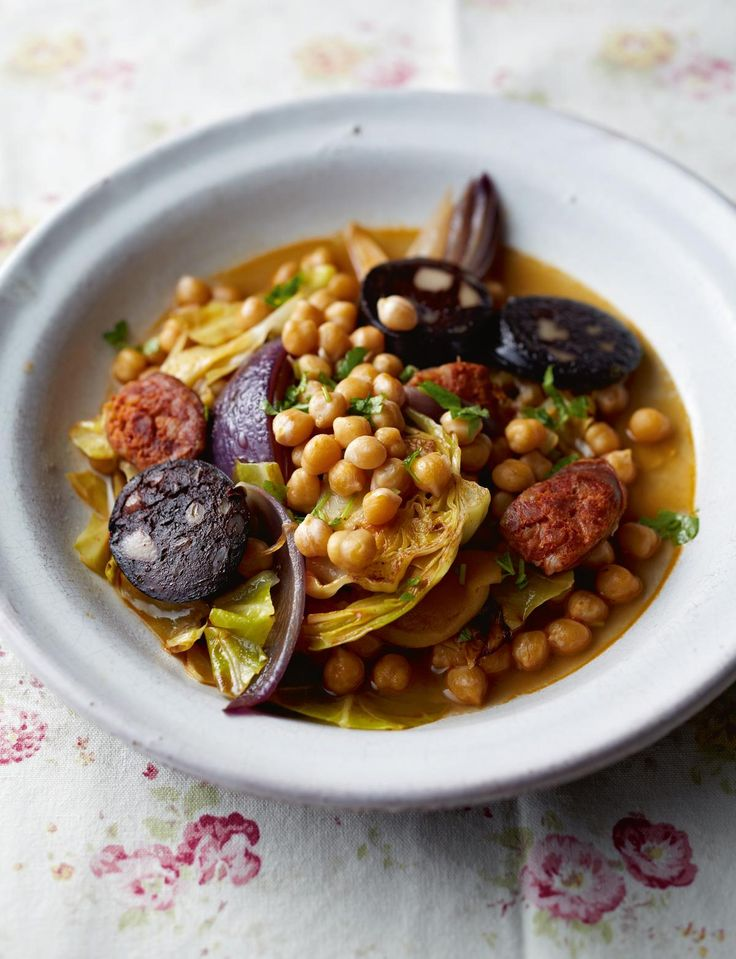 Chickpeas with Chorizo, Black Pudding and Cabbage from the Pressure Cooker Cookbook by Catherine Phipps.