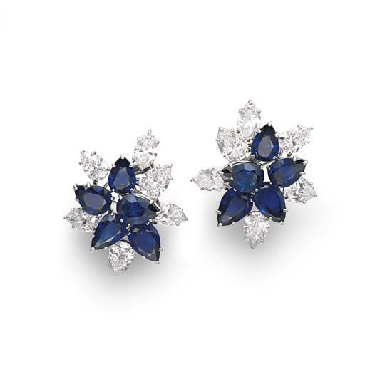 A PAIR OF SAPPHIRE AND DIAMOND EAR CLIPS, BY HARRY WINSTON   Each designed as a pear-shaped sapphire and pear and marquise-cut diamond foliate cluster, mounted in platinum, circa 1970, in a Harry Winston black suede pouch  By Harry Winston, no. 7307