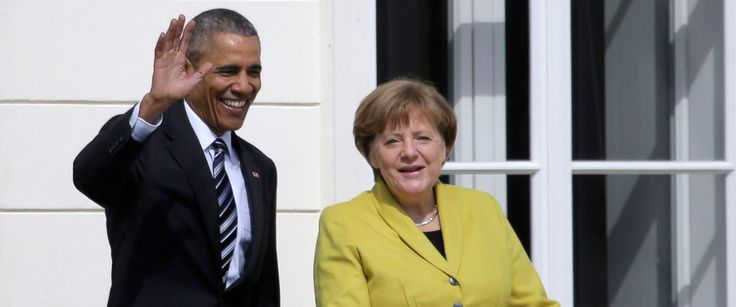 German Chancellor Angela Merkel, right, welcomes President Barack Obama at Herrenhausen Palace in Hannover, northern Germany, April 24, 2016.