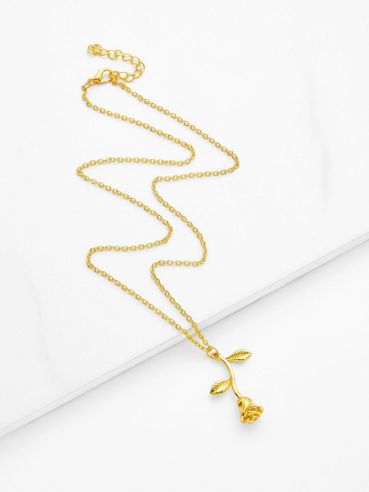 No Stone. Gold colored metal. Pendant Necklaces Flowers design. Designed in Gold.