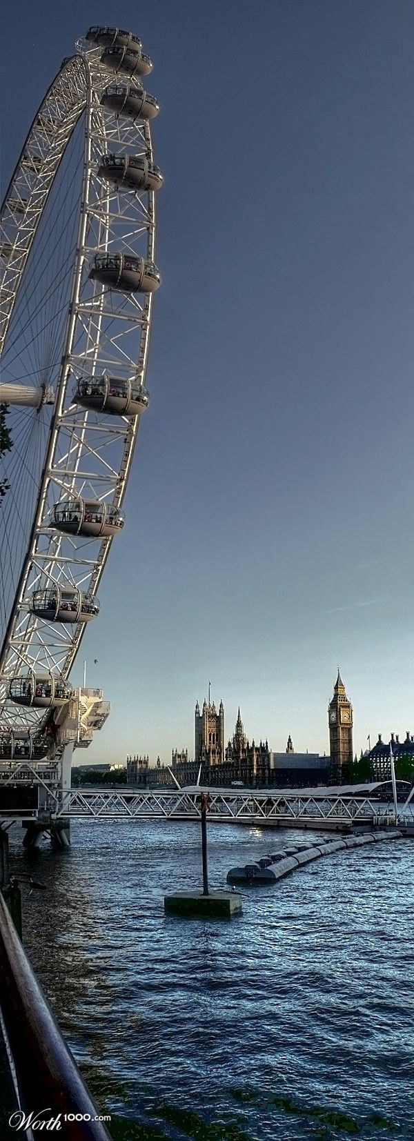 The London Eye and the Houses of Parliament in a beautiful summer afternoon...