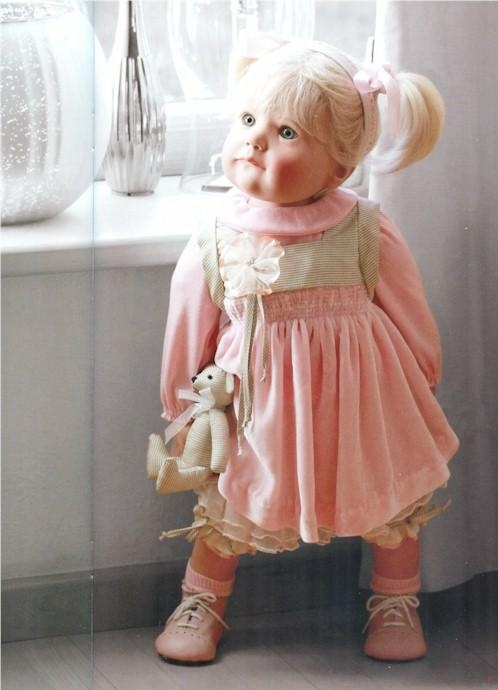 A repin of Liese, a lifelike doll with blond pigtails offered through Gotz…