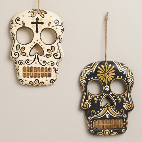 One of my favorite discoveries at WorldMarket.com: Black and Ivory Wooden Skull Wall Decor, Set of 2