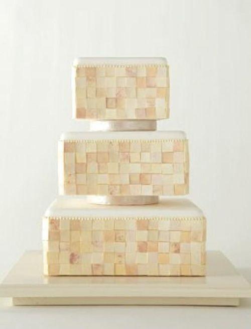 A marble-tiled, metallic wedding cake | La Forêt | Brides.com