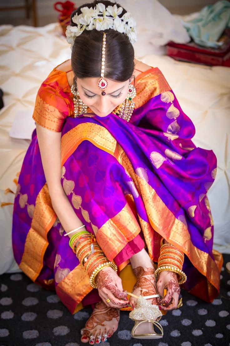 South Indian bride. Purple and orange Kanchipuram silk sari. Temple jewelry. Bun with fresh flowers. Tamil bride. Telugu bride. Kannada bride. Hindu bride.Malayalee bride.South Indian wedding.Kerala bride. Bridal henna
