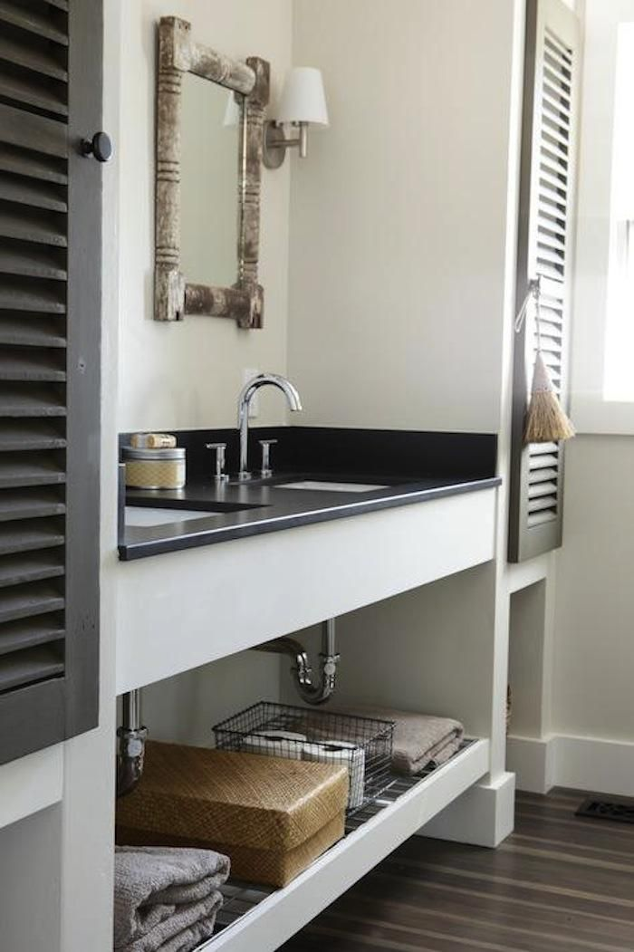 Shutters as cabinet doors.  I love the extra shelf under the sink.  Love the black, too.