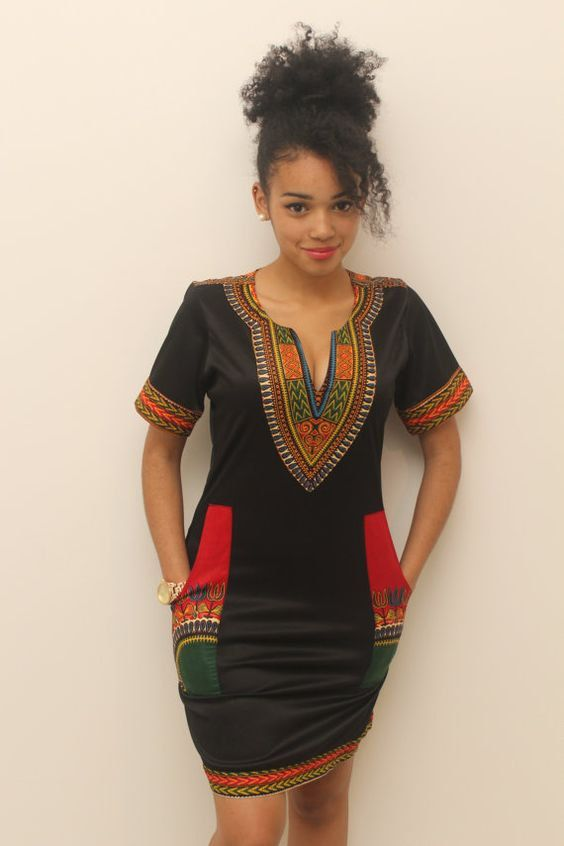 This unique pencil dress features a modern dashiki designed neckline and pockets so that you carry the important stuff, look glamorous and feel comfortable all day long. LISTING INCLUDES: - 1 Black Dress (Available in your preferred size and length) FEATURES: - Fitted 100% Cotton Pencil Dress - Round neckline with Dashiki Design - Zipper Closure on the back of the dress - Short Sleeved Design - Pockets - Available in different sizes and Lengths - Model is 176cm/5ft 9in tall and wears a UK…