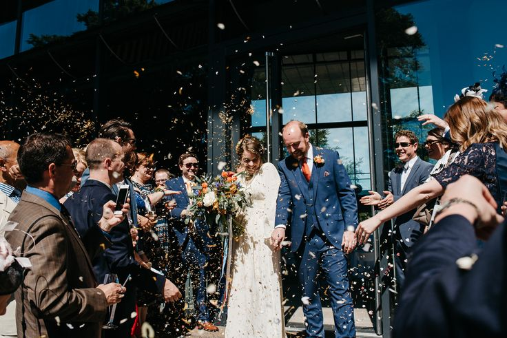 Confetti gauntlet at a colour and creative city wedding