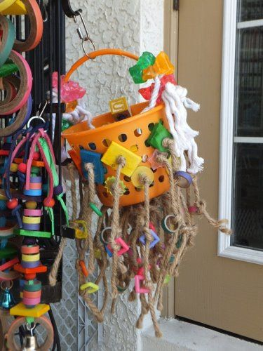 Bird toy made from bucket, rope and leather plus chew toys