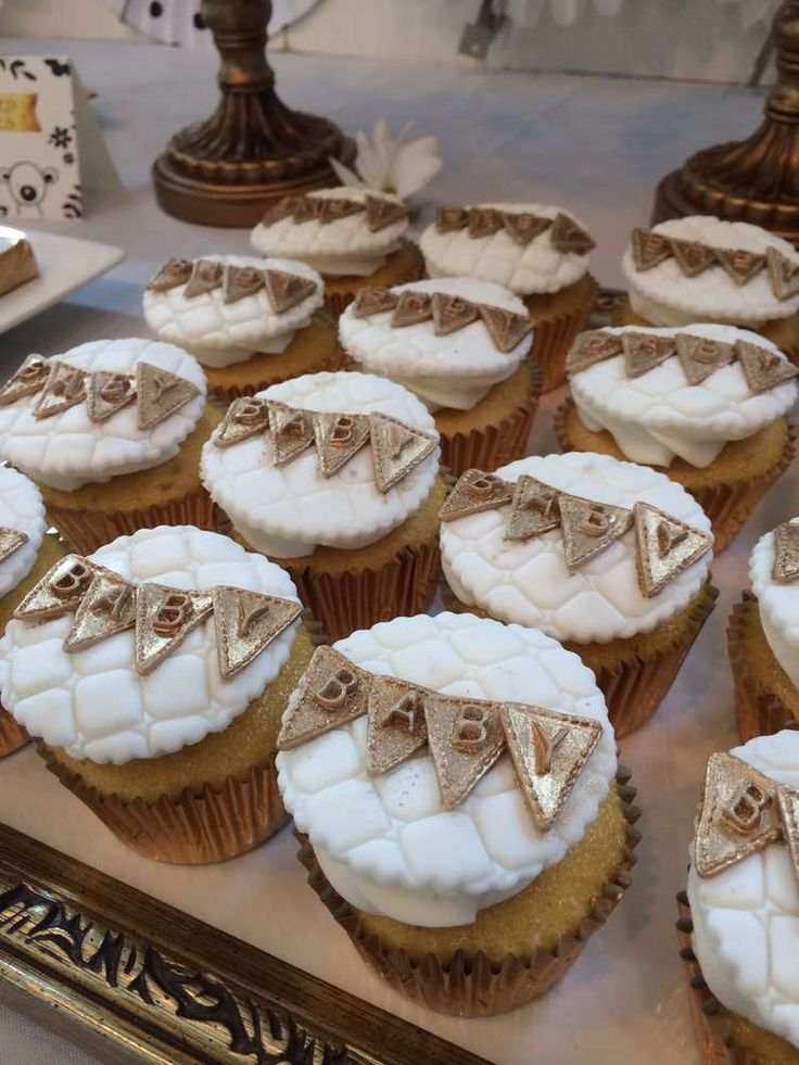 Fondant topped cupcakes at a white, black and gold baby shower party! See more party planning ideas at CatchMyParty.com!