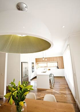 love this large light over the dining table
