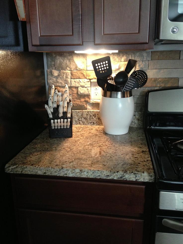 Stone Backsplash, Granite Countertops, Dark Wood Cabinets