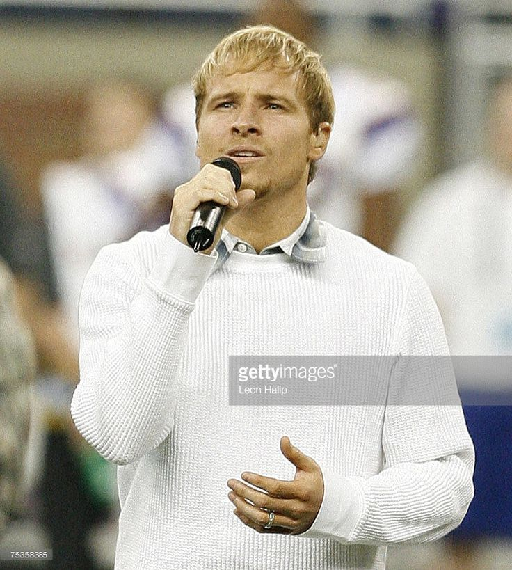 Brian Littrell from the Backstreet Boys sings the national anthem prior to the start of the game between the Minnesota Vikings and the Detroit Lions. Ford Field Detroit. December 10, 2006