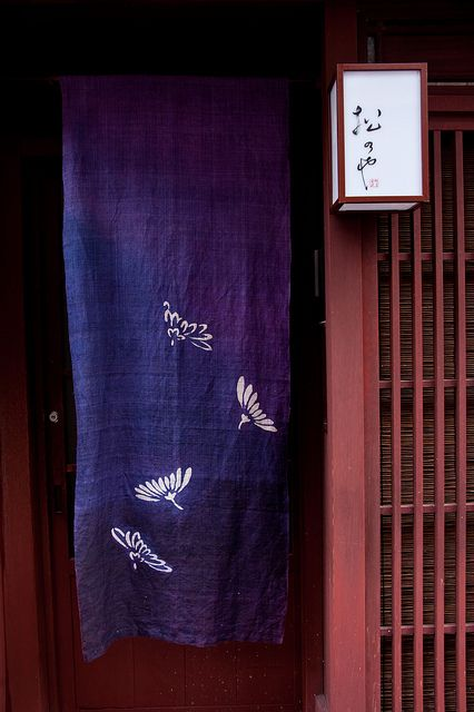 the entrance of former geisha house in the Kazue-machi geisha district in Kanazawa, Japan: photo by junog007, via Flickr