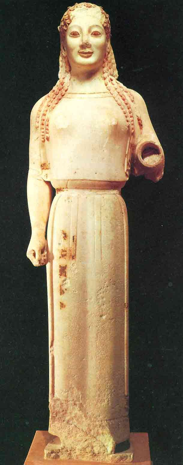 greece standing female figure w loose cloth draped over her called kore