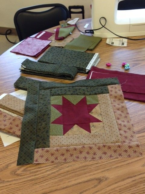 Log cabin blocks with pieced center square.