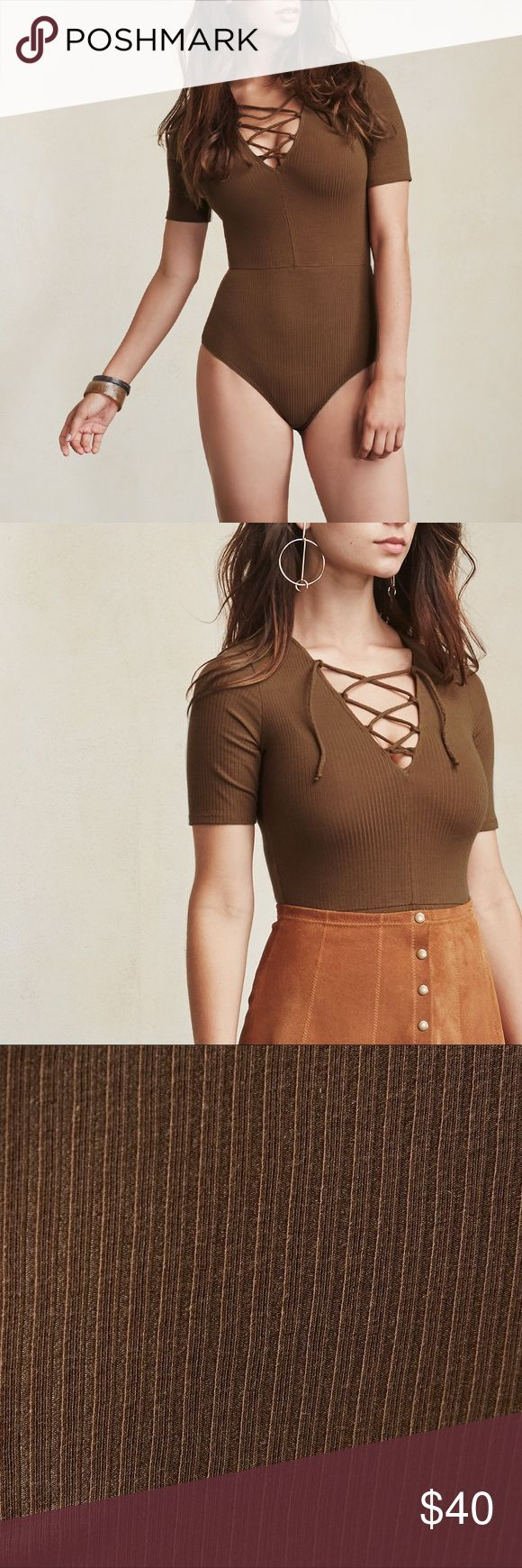 "Reformation ""Serena"" bodysuit size XS Size XS bodysuit from Reformation. Purchased new and worn a few times. You are able to wear a bra with this bodysuit and it is designed by Ref for fuller chested women! Color is a golden brown like first photos Reformation Tops"