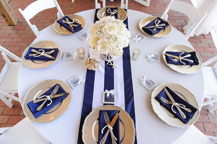 "Nautical Wedding at Cross Creek Ranch in Dover, Florida Captured by Sarah & Ben. Inspired by the groom's service in the Coast Guard, this couple put together a perfectly nautical affair where they literally ""tied the knot"" at their ceremony! Navy dresses, maritime flags and rope, and a plethora of other nautical details made this day one to remember!  You Can See More At: http://www.sarahbenblog.com/cross-creek-ranch-wedding-joanna-adam/"