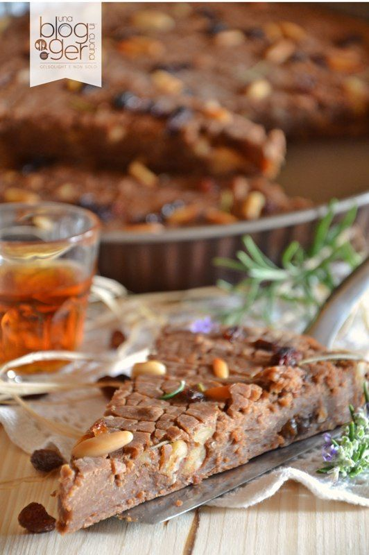 Castagnaccio toscano~ A Tuscan specialty~ a cake made with chestnut flour and pine nuts.
