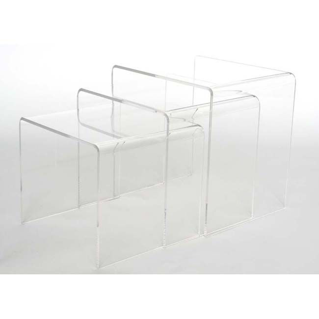 These contemporary, versatile nesting end tables make a great addition to home decor. Made of clear acrylic, the set of three end tables graduate in size and are designed to be stored together or used separately. A clear fit for any decor. Bedside tables if out bed in front of window.