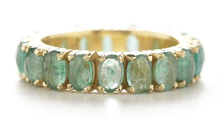 This 18k gold facet eternity ring features luxurious 5x3mm oval rose cut green…