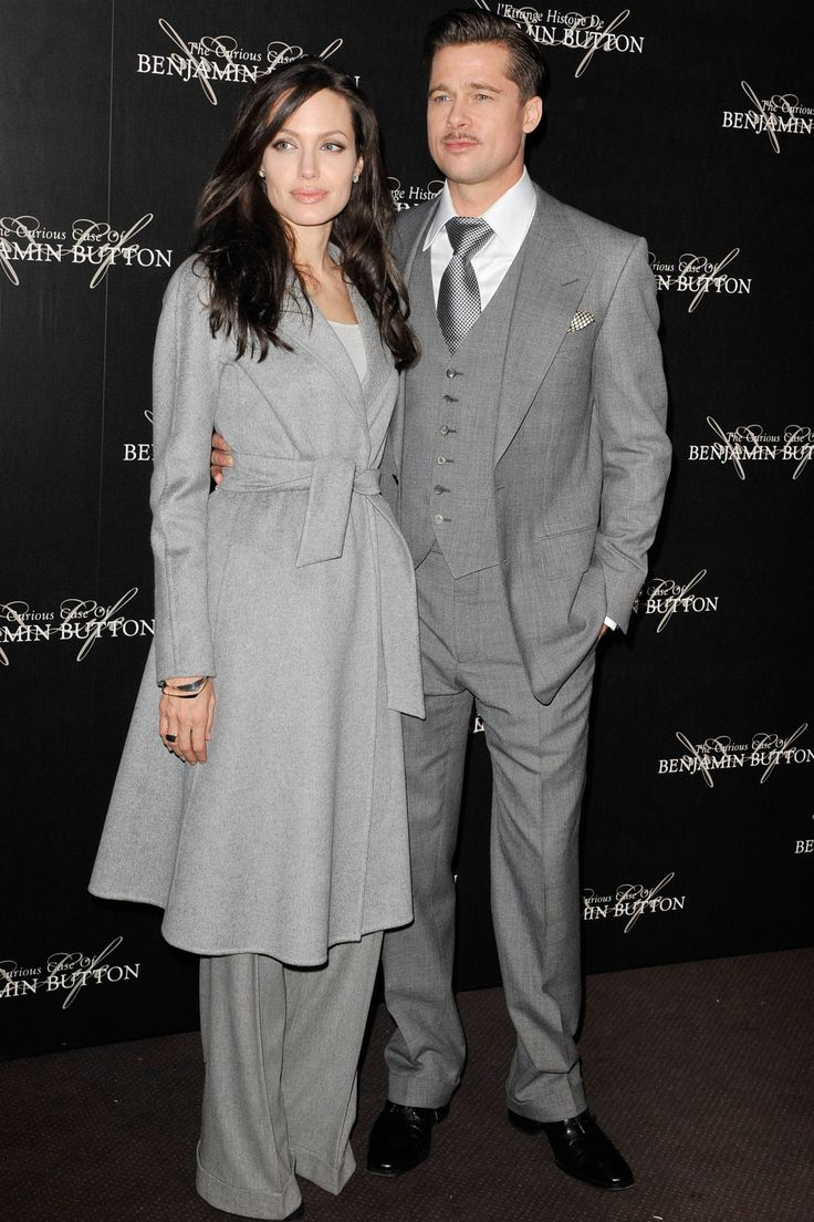 Angelina Jolie | January 2009  Brad and Angelina, both in grey, were the perfect example of power couple dressing at the Paris premiere of The Curious Case of Benjamin Button. Jolie's coat was by Akris and her trousers were by Ralph Lauren.