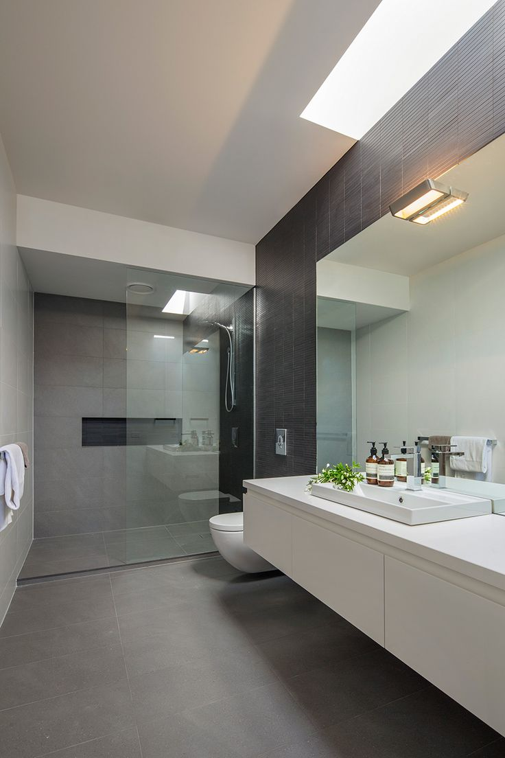 If not polished concrete then large tiles for floor and shower.