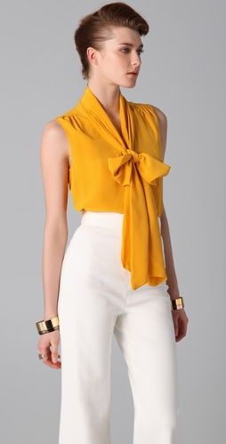 Vibrant necktie blouse seem to be a hit this season. Blouse by Viktor & Rolf and bottom by Kevork Kiledjian