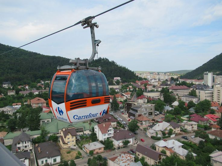 A telegondola whisks visitors from the railway station at Piatra Neamt, Romania, to a ski slope called Cozla Nature Park overlooking the city.