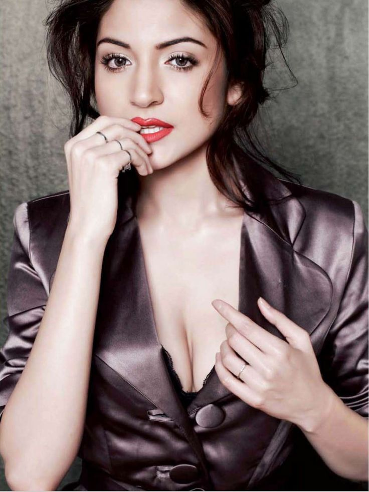 Anushka Sharma unbuttoned top , bra visible